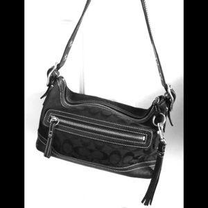Cute coach shoulder bag. Signature with tassel.
